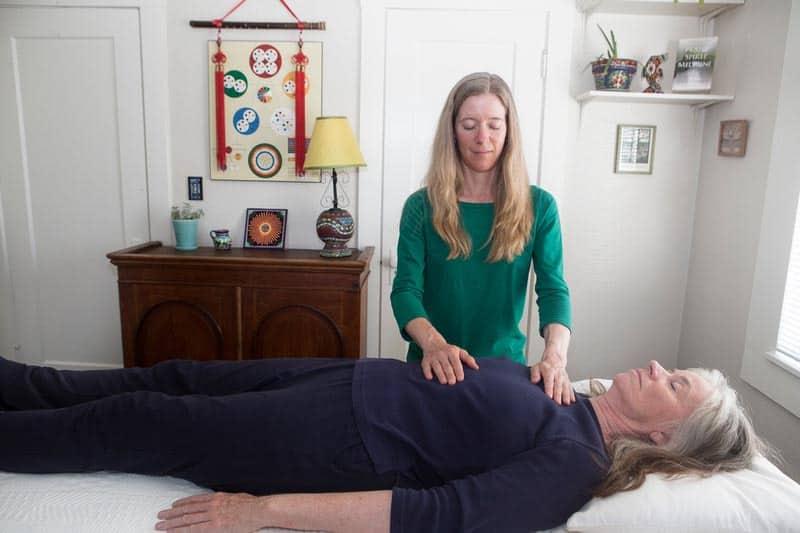 Megan Montero giving a Plant Spirit Medicine treatment to a client