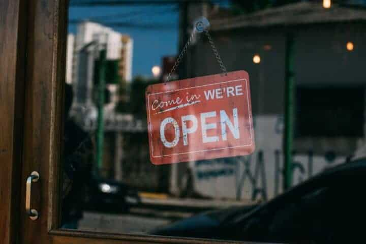 Storefront open for business sign