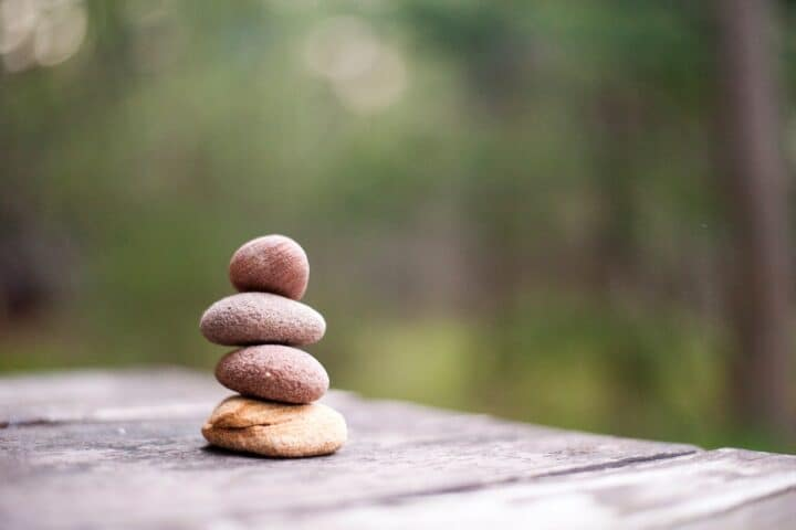 Stacked rocks on table showing the simplicity of life