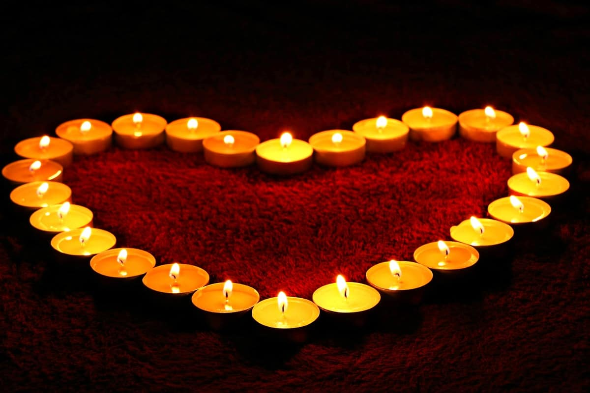 Candles arranges to be a heart