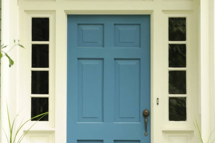 A beautiful blue front door welcomes you