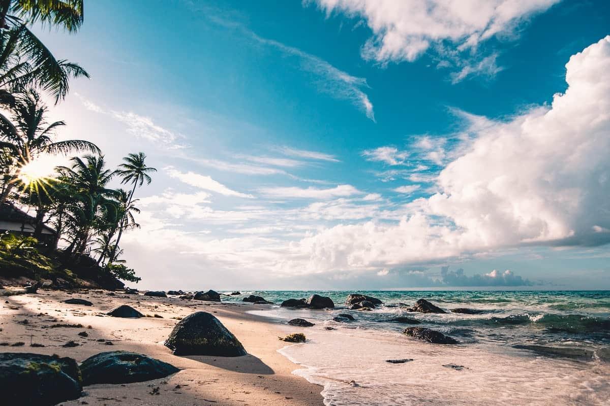 uplifting view of sky, ocean and beach