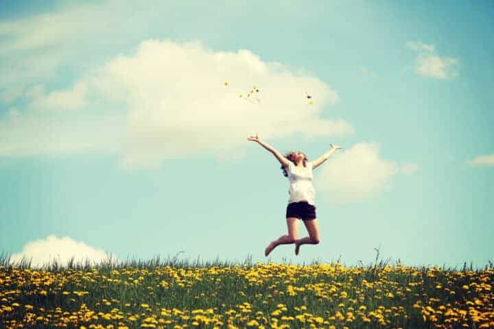 Jumping for joy in a field of dandelions